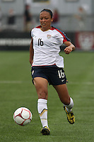 USWNT's Angela Hucles (16) dribbles the ball. The U.S. Women's National Team defeated 1-0 in a friendly match at Marina Auto Stadium in Rochester, NY on July 19, 2009. Abby Wambach of the USWNT scored her 100th career goal in the second half..