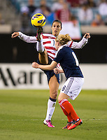 Carli Lloyd (10) of the USWNT takes the ball away from Kim Little (8) of Scotland during the game at EverBank Field in Jacksonville, Florida.  The USWNT defeated Scotland, 4-1.