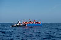 Sea Watch-2.<br /> Die Sea Watch-2 bei ihrer 13. SAR-Mission vor der libyschen Kueste.<br /> Im Bild: Ein ueberfuelltes  Schlauchboot mit ca. 160 Menschen wird von der Sea Watch-2 mit Rettungswesten versorgt.<br /> 20.10.2016, Mediterranean Sea<br /> Copyright: Christian-Ditsch.de<br /> [Inhaltsveraendernde Manipulation des Fotos nur nach ausdruecklicher Genehmigung des Fotografen. Vereinbarungen ueber Abtretung von Persoenlichkeitsrechten/Model Release der abgebildeten Person/Personen liegen nicht vor. NO MODEL RELEASE! Nur fuer Redaktionelle Zwecke. Don't publish without copyright Christian-Ditsch.de, Veroeffentlichung nur mit Fotografennennung, sowie gegen Honorar, MwSt. und Beleg. Konto: I N G - D i B a, IBAN DE58500105175400192269, BIC INGDDEFFXXX, Kontakt: post@christian-ditsch.de<br /> Bei der Bearbeitung der Dateiinformationen darf die Urheberkennzeichnung in den EXIF- und  IPTC-Daten nicht entfernt werden, diese sind in digitalen Medien nach §95c UrhG rechtlich geschuetzt. Der Urhebervermerk wird gemaess §13 UrhG verlangt.]