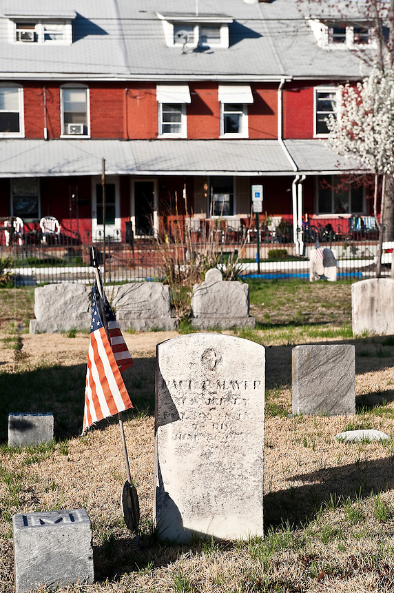 Row houses serve as the backdrop to a cemetery, Riverside, New Jersey, USA