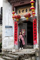 Zhenyuan, Guizhou, China.  Entrance to a Restaurant.  Spring Festival (New Year) Scrolls Proclaiming Good Business, High Profits, and Good Luck in the Coming Year.