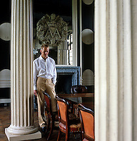 Portrait of antique dealer Andrew Allfree in the dining room of his Normandy chateau