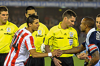 MELBOURNE, AUSTRALIA - MAY 19:  Olympiakos captain Kevin Mirallas and Victory captain Archie Thompson exchange gifts and shake hands prior to the match between Melbourne Victory and Olympiakos FC at Etihad Stadium on 19 May 2012 in Melbourne, Australia. (Photo Sydney Low /  AsteriskImages.com)