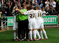 Pictured: Stephen Dobbie is mobbed by team mates after putting the home side two nil ahead<br /> Swansea City FC (white) V Nottingham Forest (red) Championship play off semi final, second leg. Liberty Stadium Swansea 16/05/11<br /> Picture by: Ben Wyeth  / Athena Picture Agency<br /> info@athena-pictures.com