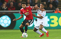 Wayne Routledge of Swansea City challenges Jesse Lingard of Manchester United during the Carabao Cup Fourth Round match between Swansea City and Manchester United at the Liberty Stadium, Swansea, Wales, UK. Tuesday 24 October 2017