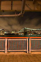 THIS IMAGE IS AVAILABLE EXCLUSIVELY FROM CORBIS.....Please search for image # 42-19896892 on www.corbis.com....Brooklyn Bridge, East River, and Overcast/Cloudy Night Sky.  Viewed from the East River Esplanade in Lower Manhattan, New York City, New York State, USA