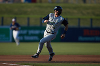 Jake Means (9) of the Columbia Fireflies hustles towards third base against the Kannapolis Cannon Ballers at Atrium Health Ballpark on May 20, 2021 in Kannapolis, North Carolina. (Brian Westerholt/Four Seam Images)