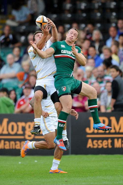 20130809 Copyright onEdition 2013 ©<br /> Free for editorial use image, please credit: onEdition.<br /> <br /> Rhys Owen of Worcester Warriors 7s battles with Ollie Turton of Leicester Tigers 7s during the finals of the J.P. Morgan Asset Management Premiership Rugby 7s Series.<br /> <br /> The J.P. Morgan Asset Management Premiership Rugby 7s Series kicked off for the fourth season on Thursday 1st August with Pool A at Kingsholm, Gloucester with Pool B being played at Franklin's Gardens, Northampton on Friday 2nd August, Pool C at Allianz Park, Saracens home ground, on Saturday 3rd August and the Final being played at The Recreation Ground, Bath on Friday 9th August. The innovative tournament, which involves all 12 Premiership Rugby clubs, offers a fantastic platform for some of the country's finest young athletes to be exposed to the excitement, pressures and skills required to compete at an elite level.<br /> <br /> The 12 Premiership Rugby clubs are divided into three groups for the tournament, with the winner and runner up of each regional event going through to the Final. There are six games each evening, with each match consisting of two 7 minute halves with a 2 minute break at half time.<br /> <br /> For additional images please go to: http://www.w-w-i.com/jp_morgan_premiership_sevens/<br /> <br /> For press contacts contact: Beth Begg at brandRapport on D: +44 (0)20 7932 5813 M: +44 (0)7900 88231 E: BBegg@brand-rapport.com<br /> <br /> If you require a higher resolution image or you have any other onEdition photographic enquiries, please contact onEdition on 0845 900 2 900 or email info@onEdition.com<br /> This image is copyright the onEdition 2013©.<br /> <br /> This image has been supplied by onEdition and must be credited onEdition. The author is asserting his full Moral rights in relation to the publication of this image. Rights for onward transmission of any image or file is not granted or implied. Changing or deleting Copyright information is illegal a