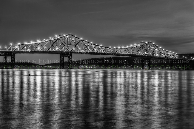 The lights of the Tappan Zee Bridge reflect off the surface of the Hudson River during evening twilight as seen from Tarrytown, New York, USA