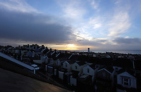 Swansea, UK. Wednesday 09 November 2016<br /> The sun rises over Swansea Bay as seen from over roof tops of the Mount Pleasant area of the city in south Wales UK.