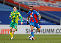 10/13th March 2021; Selhurst Park, London, England; English Premier League Football, Crystal Palace versus West Bromwich Albion; Jordan Ayew of Crystal Palace chased down by Conor Townsend of West Bromwich Albion