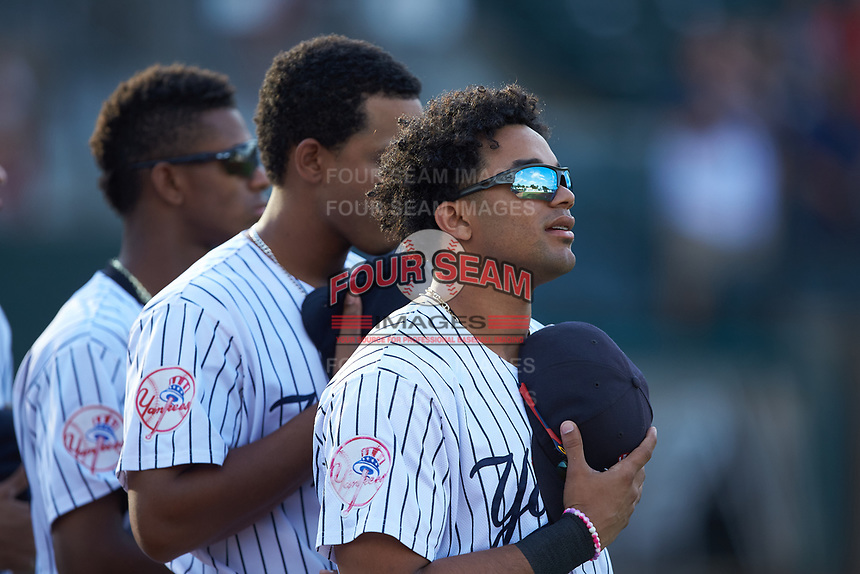 Robert Javier (33) of the Pulaski Yankees stands for the National Anthem prior to the game against the Burlington Royals at Calfee Park on September 1, 2019 in Pulaski, Virginia. The Royals defeated the Yankees 5-4 in 17 innings. (Brian Westerholt/Four Seam Images)