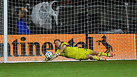 LAKE BUENA VISTA, FL - JULY 26: Tim Melia of Sporting KC saves a shootout attempt by Yordy Reyna of Vancouver Whitecaps FC during a game between Vancouver Whitecaps and Sporting Kansas City at ESPN Wide World of Sports on July 26, 2020 in Lake Buena Vista, Florida.