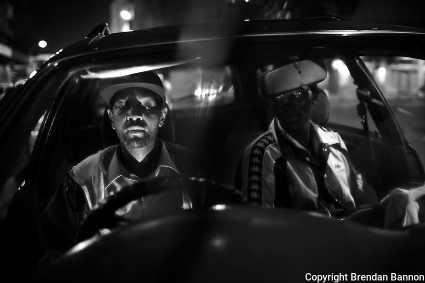 Taxi Driver Walter Njau (L) and car wash man John Mgogo in Nairobi.