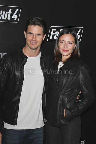 LOS ANGELES, CA - NOVEMBER 5: Robbie Amell and Italia Ricci at the Fallout 4 video game launch event in downtown Los Angeles on November 5, 2015 in Los Angeles, California. Credit: mpi21/MediaPunch