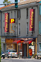 A wine shop 'La Bouteillerie' in Condrieu with big signs advertising Cote Rotie and Condrieu. Condrieu, Rhone, France, Europe