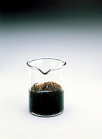 CARBONIZATION OF SUCROSE <br /> (4 of 5)<br /> Midpoint Of Reaction<br /> Sulfuric Acid (H2SO4) has a very strong affinity for water & can be used to dehydrate carbohydrates. It reacts with sucrose (C12H22O11) in beaker removing 11 molecules of water from each molecule of sucrose.