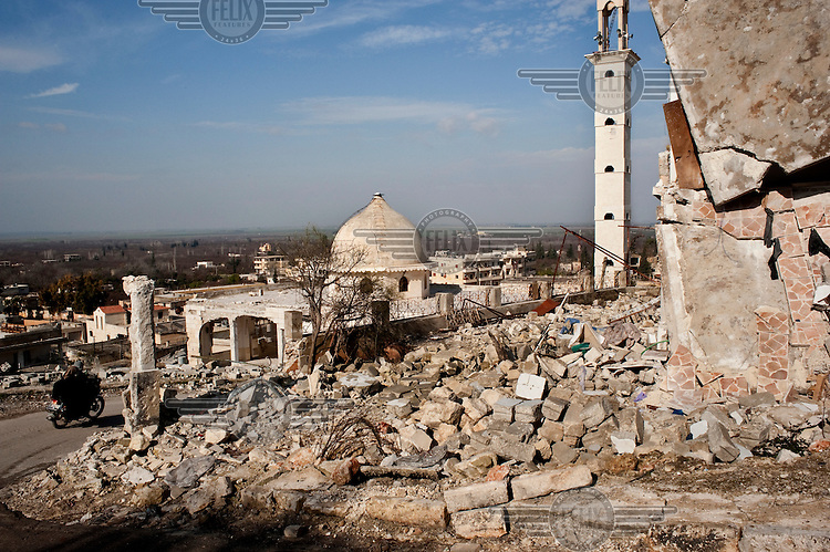 A view of the mosque which was hit while prayers were taking place inside during fighting between the Free Syrian Army and soldiers from the national army in Harem which was taken by the Free Syrian Army on 25 December 2012. Protests against the regime of Bashar al-Assad erupted in March 2011. Although initially peaceful, they were violently repressed by the Syrian army and police. In response to being ordered to shoot unarmed civilians, large numbers of men deserted and formed the core of the Free Syrian Army (FSA) which was soon joined by civilian volunteers. Since early 2012 the protest movement has escalated into an armed uprising that many consider a civil war. Sustained fighting is ongoing throughout Syria between the regular army and its allied militias and the Free Syrian Army as well as other anti-regime groups, some of which include foreign jihadists. ..