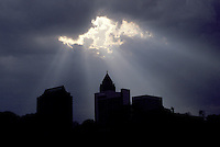 clouds, sun ray, Georgia, GA, Atlanta, Sun rays break through the clouds after a rain storm above the silhouette of the IBM Tower in downtown Atlanta.