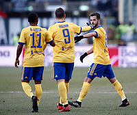 Calcio, Serie A: Bologna vs Juventus, stadio Renato D'Allara, Bologna,17 dicembre 2017.<br /> Juventus' Miralem Pjanic (r) celebrates after scoring with his teammates Douglas Costa (l) and Gonzalo Higuain (c) during the Italian Serie A football match between Bologna and Juventus at Bologna's Renato D'Allara stadium, December 17, 2017.<br /> UPDATE IMAGES PRESS/Isabella Bonotto