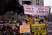 """Manila, Philippines<br /> February 1986<br /> <br /> Corazon Aquino campaigning for President of the Philippines in 1986.<br /> <br /> Corazon Aquino was born into one of the wealthiest families in the Philippines, Mrs. Aquino began her political education by playing the dutiful wife as the political career of her husband, Benigno Aquino Jr., expanded. In less than 20 years he emerged as one of the chief potential rivals of Mr. Marcos, who was then president. When Mr. Marcos declared martial law in 1972, her husband was arrested and imprisoned for seven years. .He was assassinated in 1983 after returning to the Philippines from a three-year exile in the United States. Mr. Marcos was widely blamed for the murder. It was at Mr. Aquino's funeral that Mrs. Aquino, became a national symbol, demonstrating the dignity and composure that would characterize her most difficult moments as president. <br /> <br /> Mrs. Aquino came to power through what amounted to popular acclaim -- what the Philippino people called """"people power"""" -- expressed by huge crowds that gathered in support of her. Her popularity reached its peak during her presidential campaign against Mr. Marcos in January 1986, when she was surrounded by enthusiastic crowds chanting, """"Cory! Cory! Cory!'""""<br /> <br /> Her act of knocking down a dictator and bringing democracy to the Philippines was a high point in the country's modern history, and it offered a model for nonviolent uprisings that has been repeated often in other countries.<br /> <br /> Mrs. Aquino, was often criticized as an indecisive and ineffectual leader. But she combined passivity and stubbornness and an unexpected shrewdness to hold firm against powerful opponents from both the right and the left, and one of her greatest accomplishments as president was fending off a half dozen coup attempts. <br /> <br /> The restoration of democracy, and the transition to a new president, were Mrs. Aquino's prime legacies. Yet she led demonstrations against al"""