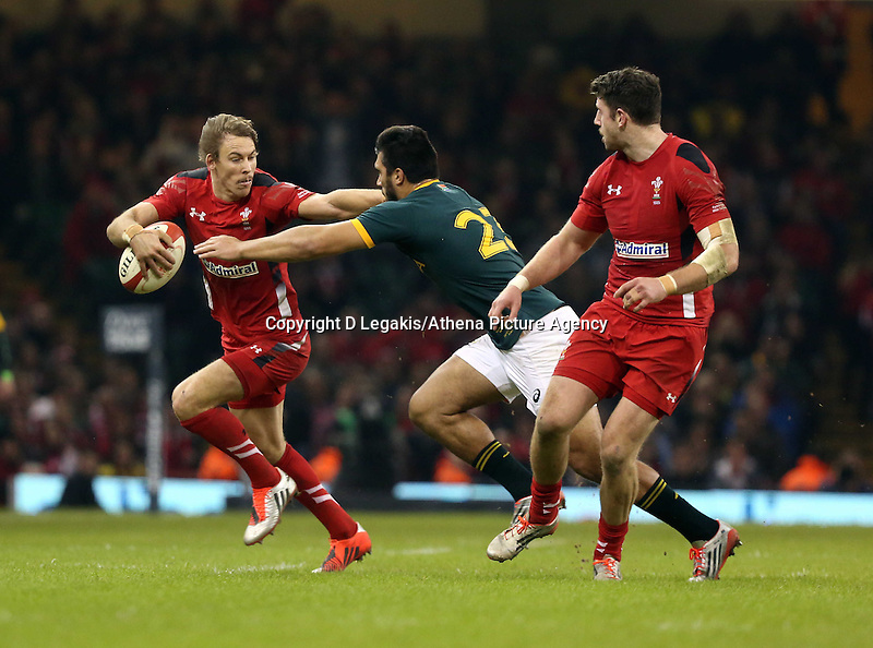 Pictured L-R: Liam Williams of Wales holds Damian de Allende away Saturday 29 November 2014<br /> Re: Dove Men Series 2014 rugby, Wales v South Africa at the Millennium Stadium, Cardiff, south Wales, UK.