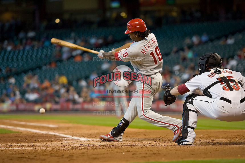 Philadelphia Phillies shortstop Michael Martinez #19 swings during the Major League Baseball game against the Houston Astros at Minute Maid Park in Houston, Texas on September 14, 2011. Philadelphia defeated Houston 1-0 to clinch a playoff berth.  (Andrew Woolley/Four Seam Images)