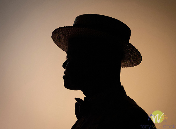 Silhouette of man with straw hat. Dandy Wellington singer and dancer. Dan Levinson band. 'Hot nights in Harlem'<br />  Gotham SophistiCats