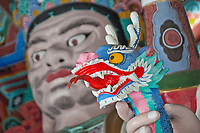 A close-up of a detailed figure at the Gate of the Four Heavenly Kings of Mu-Ryang-Sa (or Broken Ridge Temple), a Korean Buddhist temple in Palolo Valley, Honolulu, O'ahu, whose offerings include Buddhist teachings and meditation.
