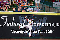 Starlin Rodriguez (27) of the Springfield Cardinals fails to make a leaping catch during a game against the Northwest Arkansas Naturals at Hammons Field on August 23, 2013 in Springfield, Missouri. (David Welker/Four Seam Images)