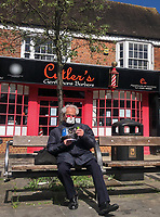 Member of the public takes sit down in High Wycombe town centre during Easter bank holiday Monday during the Covid-19 Pandemic as the UK Government advice to maintain social distancing and minimise time outside in High Wycombe on 13 April 2020. Photo by PRiME Media Images.