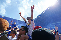A little boy celebrates after the final whistle as Cardiff are automatically promoted to the Premier League during the Sky Bet Championship match between Cardiff City and Reading at The Cardiff City Stadium, Wales, UK. Sunday 06 May 2018