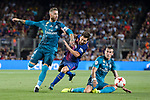 Lionel Messi of FC Barcelona (C) fights for the ball with Gareth Bale (R) and Sergio Ramos of Real Madrid (L) during the Supercopa de Espana Final 1st Leg match between FC Barcelona and Real Madrid at Camp Nou on August 13, 2017 in Barcelona, Spain. Photo by Marcio Rodrigo Machado / Power Sport Images