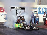 Jan. 2000; Chandler, AZ, USA; NHRA top fuel dragster driver Cory McClenathan does a burnout during pre season testing at Firebird International Raceway. Mandatory Credit: Mark J. Rebilas-