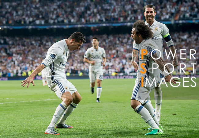 Cristiano Ronaldo (l) of Real Madrid celebrates with teammate Marcelo Vieira Da Silva during their 2016-17 UEFA Champions League Quarter-finals second leg match between Real Madrid and FC Bayern Munich at the Estadio Santiago Bernabeu on 18 April 2017 in Madrid, Spain. Photo by Diego Gonzalez Souto / Power Sport Images