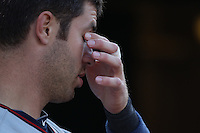 OAKLAND, CA - JULY 30:  Joe Mauer #7 of the Minnesota Twins wipes his eyes in the dugout during the game against the Oakland Athletics at the Oakland-Alameda County Coliseum on July 30, 2011 in Oakland, California. Photo by Brad Mangin