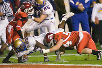 23 December 2006: Tulsa running back Courtney Tennial (#20) dives just short of the goal line during the 2006 Bell Helicopters Armed Forces Bowl between The University of Tulsa and The University of Utah at Amon G. Carter Stadium in Fort Worth, TX.