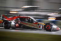 The #0 DeltaWing racer of Andy Meyrick, Katherine Legge, Alexander Ross and Gabby Chaves races through the night , Rolex 24 at Daytona, Daytona International Speedway, Daytona Beach, FL, January 2014.  (Photo by Brian Cleary/www.bcpix.com)