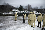 November 24, 2008. Rural Virginia.. At the New River Tree Co. loading yard in Virginia, workers wait for the semi trucks to show up and be loaded with trees, most of which are heading to Florida. All the trees are grown in North Carolina, but the closest loading area is just over the border in Virginia.. New River Tree Co. has 30 full time employees and uses 60 H2A, the Federal guest worker program, workers during harvest season. Most of the guest workers are from Mexico and many return year after year to work on the same farm in North Carolina. The pay rate is federally mandated at $9/hr. and the workers are housed in government regulated housing facilities.. In the week leading up to Thanksgiving, the farm will load 30 trucks a day, with 600 tree per truck.