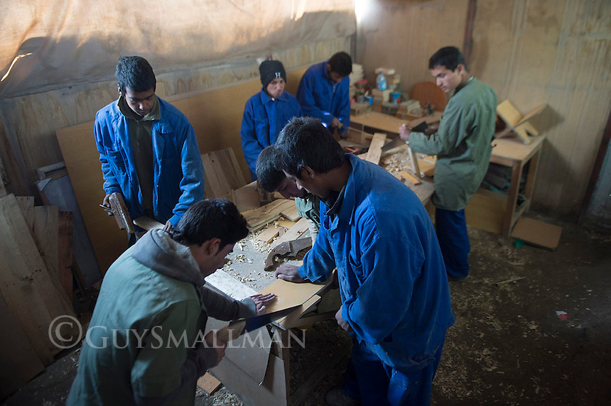 Ascianna Centre Kabul 14-1-14 Vocational training at the Headquarters of the Ascianna NGO in Kabul. The Eurpean Commission recenly withdraw their funding for Ascianna which had to close most of its projects around the country reducing its staff from 150 to 35. Their work is geared towards helping poor, refugee and underpriviledged Afghan children. A carpentry workshop.