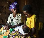 Community Health Worker Marie Chantal monitors a mom nursing her three-week old newborn in Batamuliza Hururiro village, near Rukumo Health Center, Rwanda....