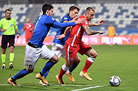 Alessandro Bastoni and Nicolo Barella of Italy  and Kamil Grosicki of Poland compete for the ball during the Uefa Nation League Group Stage A1 football match between Italy and Poland at Citta del Tricolore Stadium in Reggio Emilia (Italy), November, 15, 2020. Photo Andrea Staccioli / Insidefoto