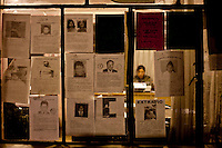 Window in a Police Station with signs of missing people.Just 25 years ago it was a small group of houses around La Paz  airport, at an altitude of 12,000 feet. Now El Alto city  has  nearly one million people, surpassing even the capital of Bolivia, and it is the city of Latin America that grew faster .<br /> It is also a paradigmatic city of the tubles and traumas of the country. There got refugee thousands of miners that lost  their jobs in 90 ´s after the privatization and closure of many mines. The peasants expelled by the lack of land or low prices for their production. Also many who did not want to live in regions where coca  growers and the Army  faced with violence.<br /> In short, anyone who did not have anything at all and was looking for a place to survive ended up in El Alto.<br /> Today is an amazing city. Not only for its size. Also by showing how its inhabitants,the poorest of the poor in one of the poorest countries in Latin America, managed to get into society, to get some economic development, to replace their firs  cardboard houses with  new ones made with bricks ,  to trace its streets,  to raise their clubs, churches and schools for their children.
