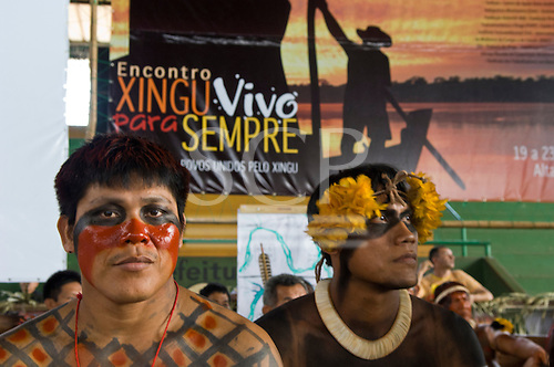 """Altamira, Brazil. """"Xingu Vivo Para Sempre"""" protest meeting about the proposed Belo Monte hydroeletric dam and other dams on the Xingu river and its tributaries. Marcelo and Pablo Kamaiura. Poster 'Xingu, alive forever, united peoples for the Xingu."""""""