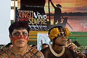 "Altamira, Brazil. ""Xingu Vivo Para Sempre"" protest meeting about the proposed Belo Monte hydroeletric dam and other dams on the Xingu river and its tributaries. Marcelo and Pablo Kamaiura. Poster 'Xingu, alive forever, united peoples for the Xingu."""
