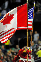 7 December 2008:  A Canadien Colour Guard Regiment presents the flags of Canada and the United States of America prior to the first regular season NFL game ever to be played in Canada between the Buffalo Bills and the Miami Dolphins at the Rogers Centre in Toronto, Ontario, Canada. The Dolphins defeated the Bills 16-3 in the historic event...Mandatory Photo Credit: Ed Wolfstein Photo