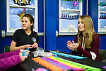 "Torrington, CT- 01 December 2016-123116CM03-  Alyssa Archambault 14, left, and Olivia Lemieux 17, both of Torrington, make New Years hats for children during a ""Last Night"" New Year's eve celebration at the Armory Torrington on Saturday.  The family event put on by the Torrington Parks and Recreation Department featured dancing performances, music by DJ Patti Adkins, games, craft stations, a Mad Science experiment station, face painting, and photo booth.   Christopher Massa Republican-American"