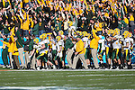 North Dakota State Bison players and coaches celebrate after a touchdown during the FCS Championship game between the North Dakota State Bison and the Sam Houston State Bearkats at the FC Dallas Stadium in Frisco, Texas. North Dakota defeats Sam Houston 39 to 13..