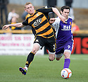 Alloa's James Doyle is pused off the ball by Annan's Graeme Bell