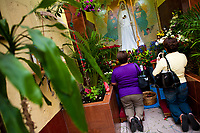 Mexican worshippers of Santa Muerte (Saint Death) pray in a temple in the historical center of Mexico City, Mexico, 1 June 2011. The religious cult of Santa Muerte is a syncretic fusion of Aztec death worship rituals and Catholic beliefs. Born in lower-class neighborhoods of Mexico City, it has always been closely associated with crime. In the past decades, original Santa Muerte's followers (such as prostitutes, pickpockets and street drug traffickers) have merged with thousands of ordinary Mexican Catholics. The Saint Death veneration, offering a spiritual way out of hardship in the modern society, has rapidly expanded. Although the Catholic Church considers the Santa Muerte's followers as devil worshippers, on the first day of every month, crowds of believers in Saint Death fill the streets of Tepito. Holding skeletal figurines of Holy Death clothed in a long robe, they pray for power healing, protection and favors and make petitions to 'La Santísima Muerte', who reputedly can make life-saving miracles.